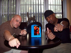 Johnny Juice and Chuck D - Showing the new eMotion Digital Frame DVD Player